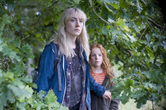 Daisy (Saoirse Ronan) and Piper (Harley Bird) on the run from pretty much everyone. The spend an inordinate amount of time in forests but surprisingly for a New York teen on anxiety medication, Daisy is adept with a map and a compass. Harley Bird is the youngest BAFTA winner for her voice work as Peppa Pig.